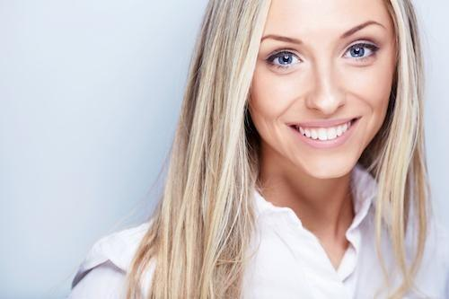 Blonde woman smiling | Dentist Calgary AB