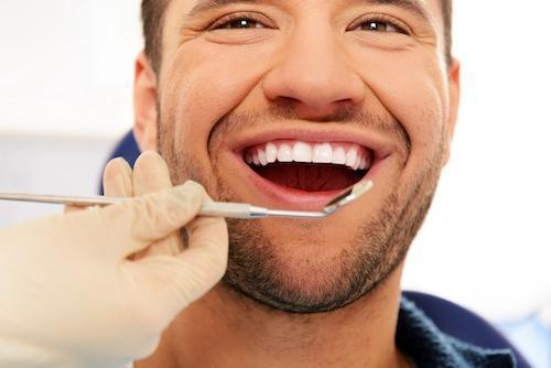 Man getting dental exam | Dentist Calgary AB