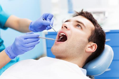 Man in dental chair | Dentist Calgary AB