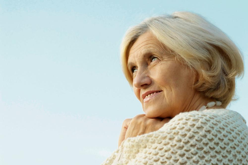 Older woman looking off into distance | dentist calgary ab