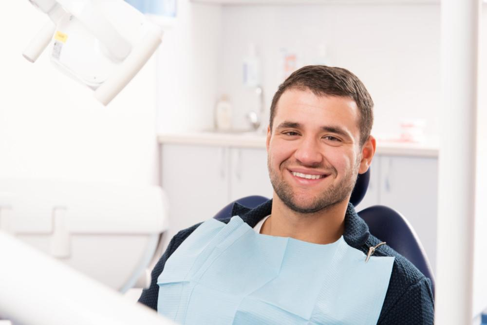 Man smiling in dental chair | Dentist Calgary AB
