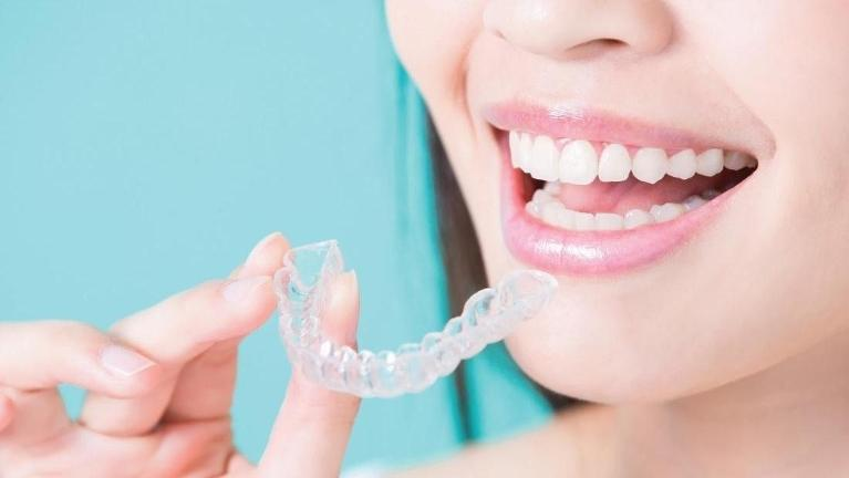 Woman Using Invisalign | Dentist Calgary AB